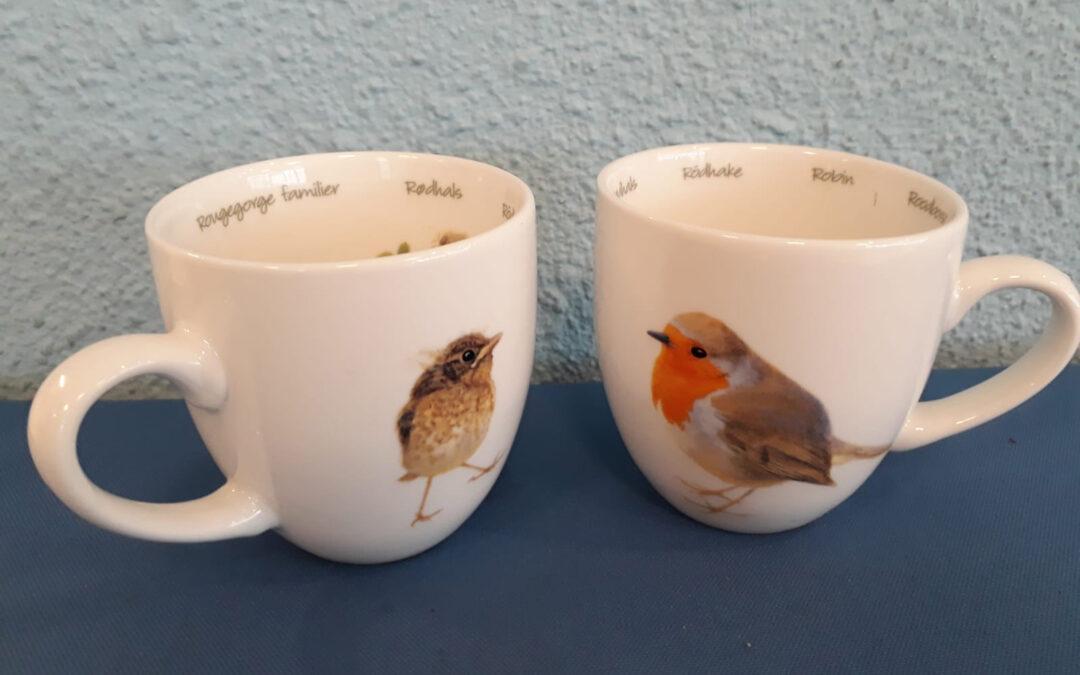 Koffiekopjes met roodborstjes